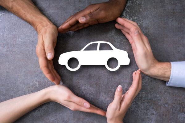 diverse hands surrounding a car